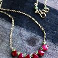 strawberry necklace . ruby + peridot